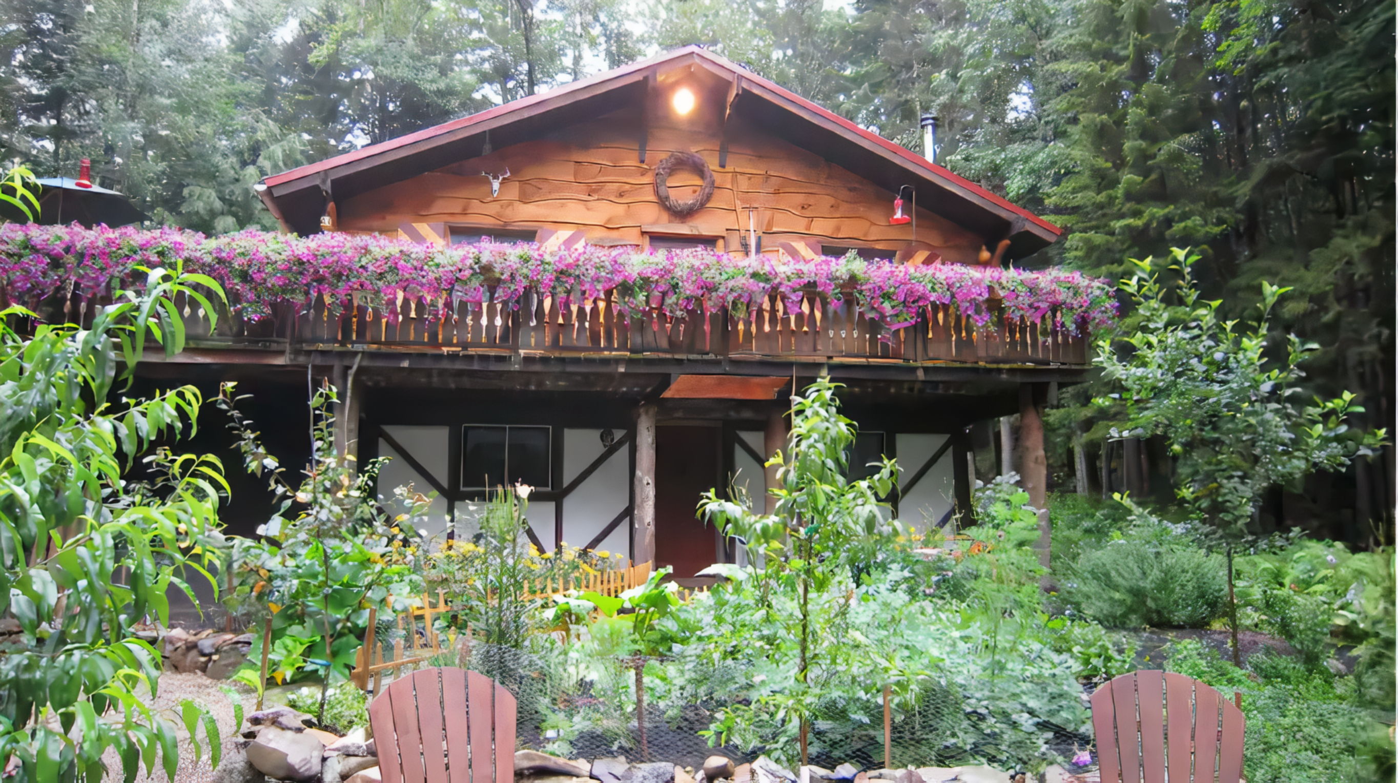 A close up of a flower garden in front of a building at Welch Mountain Chalet.