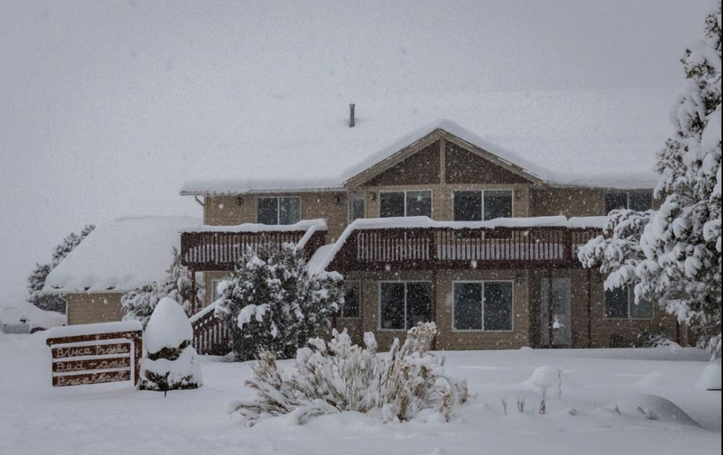 A house covered in snow at Bryce Trails Bed and Breakfast.