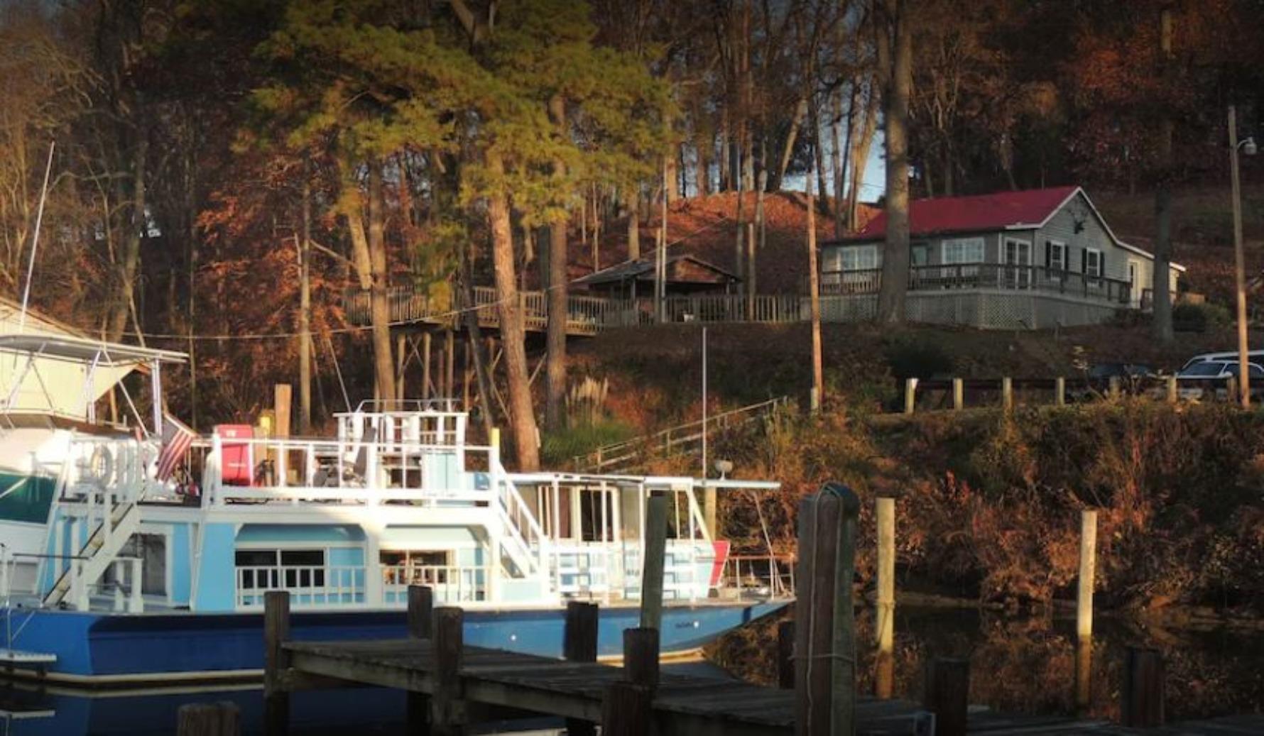 A boat docked at a dock at M/V Giamaria.