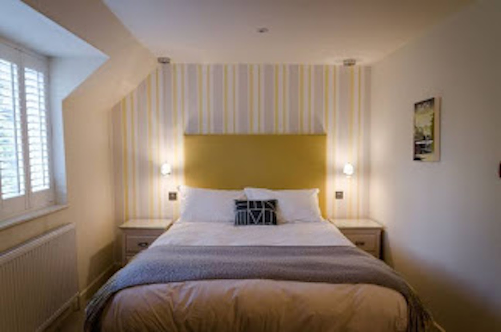 A bedroom with a bed and a window at The Northey Arms.