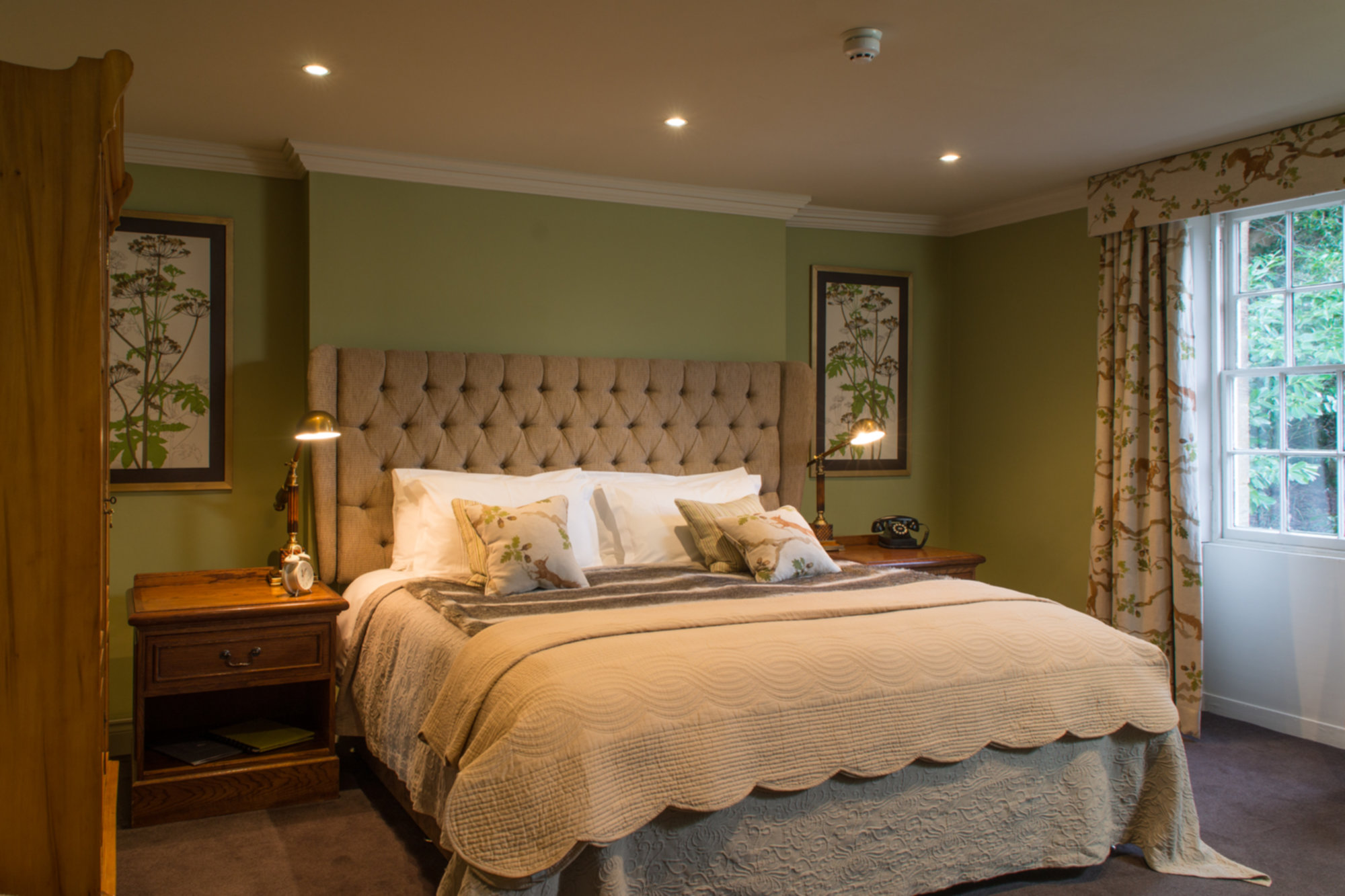 A bedroom with a large bed in a hotel room at The Northumberland Arms.