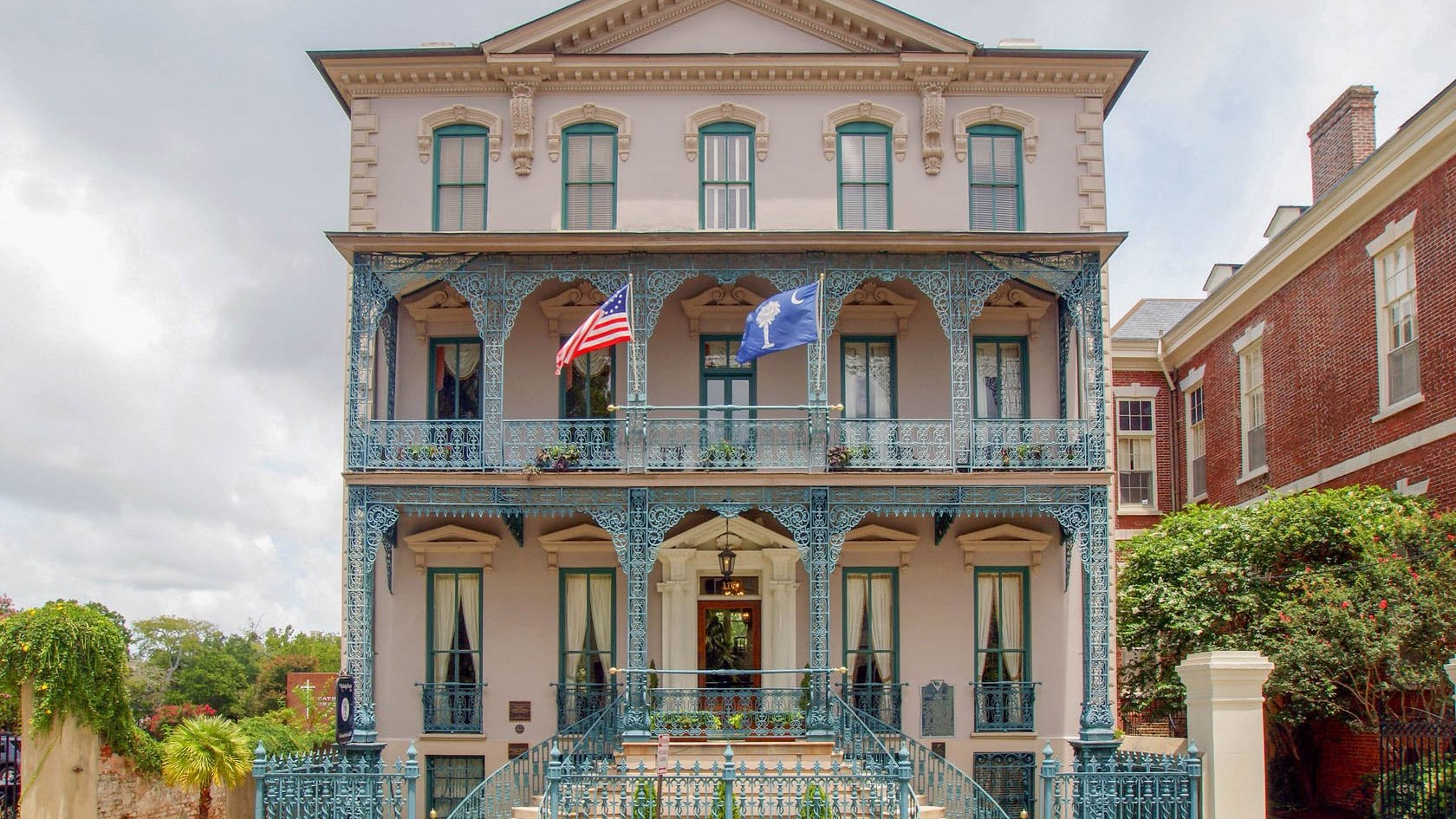 A statue in front of a building at John Rutledge House Inn.