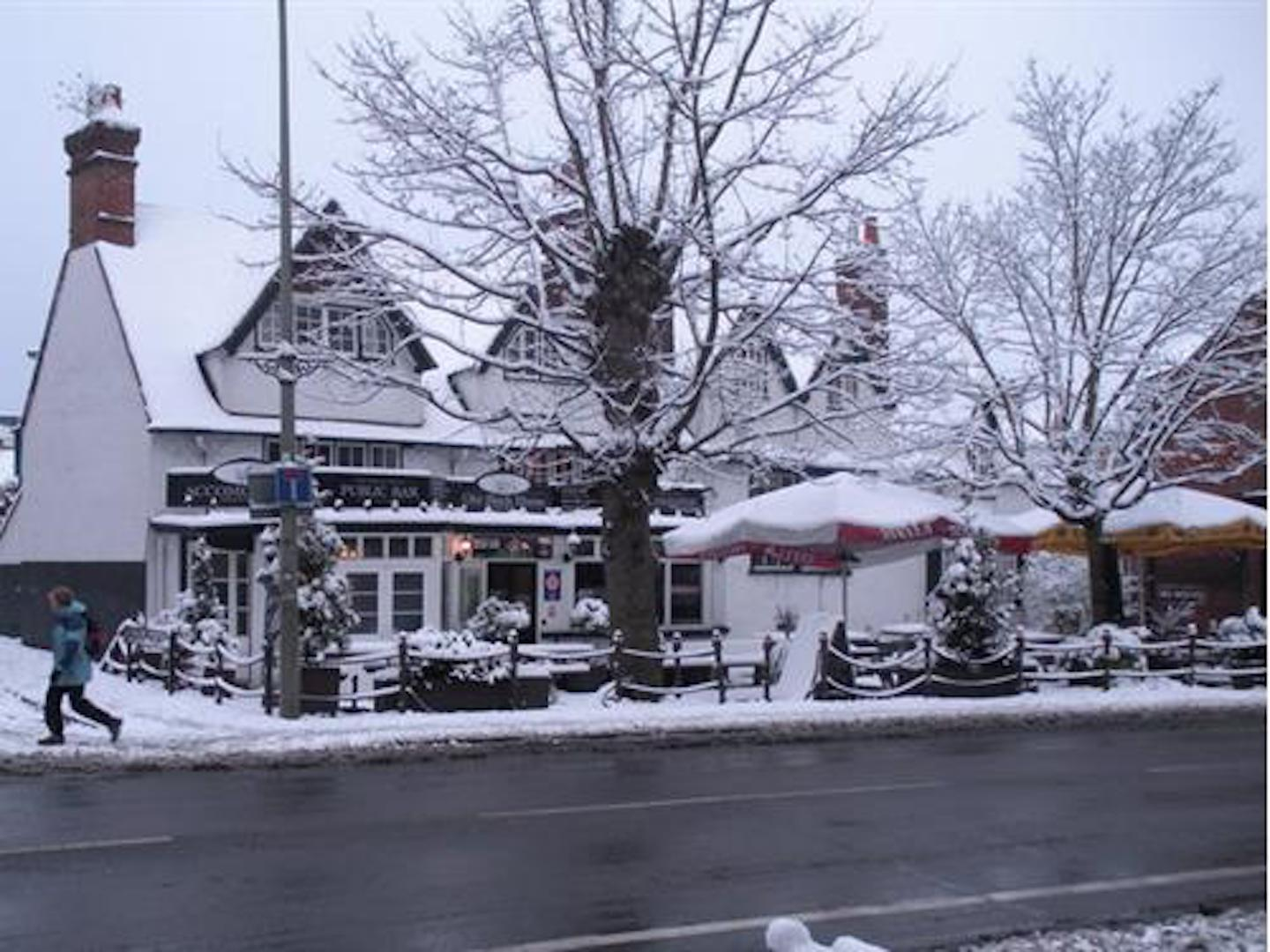A house covered in snow at The Old Black Horse.