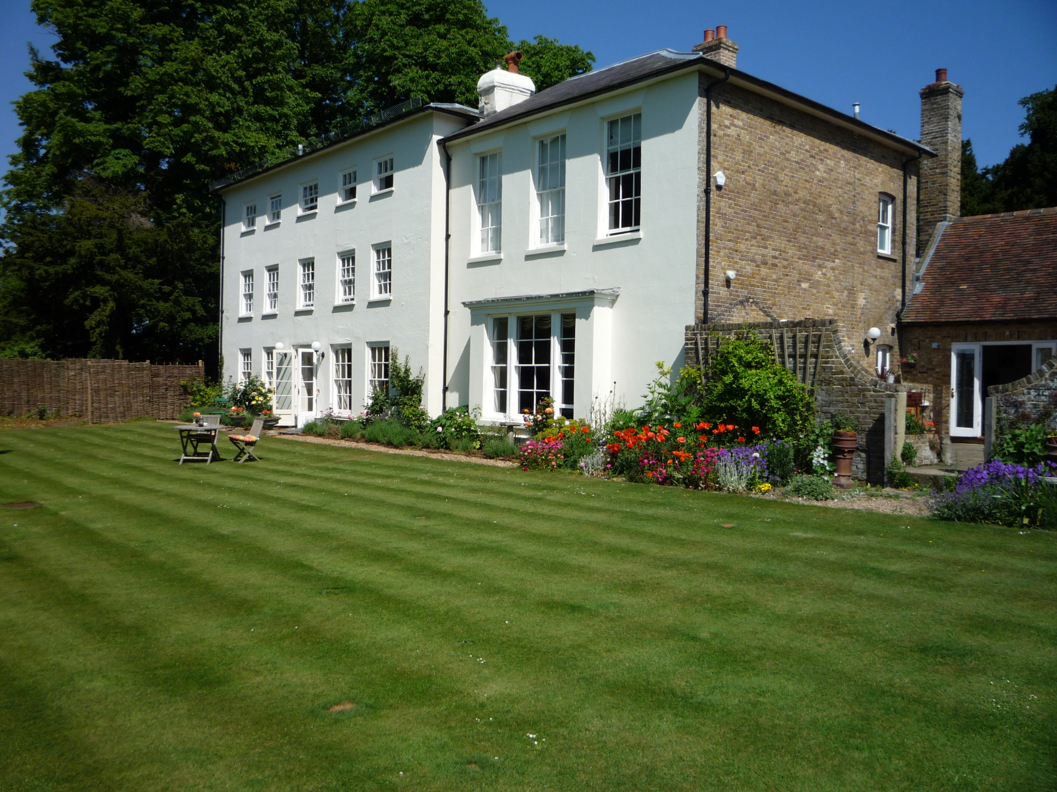 A large lawn in front of a house at The Old Vicarage.