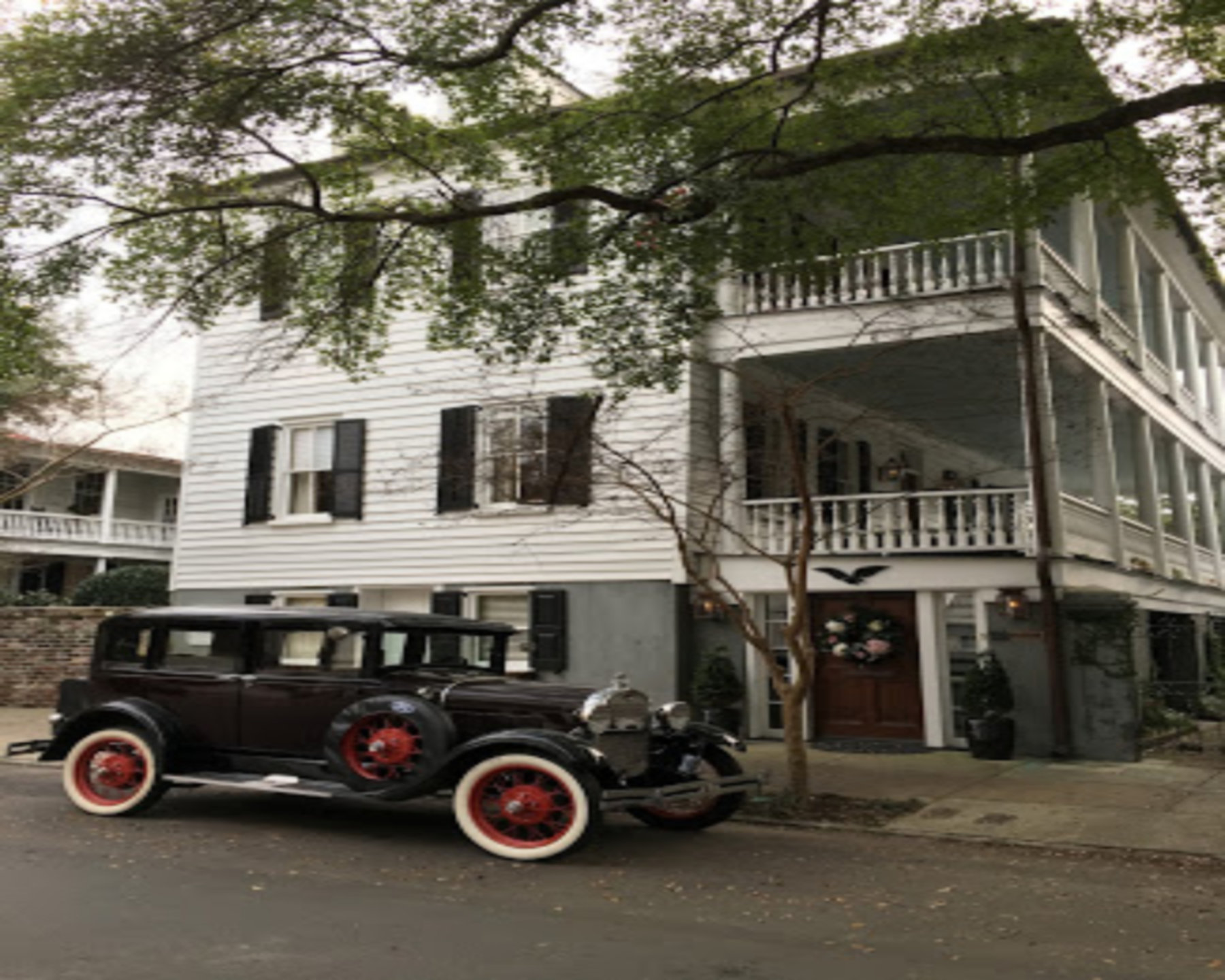A car parked in front of a building at 1837 Bed and Breakfast.