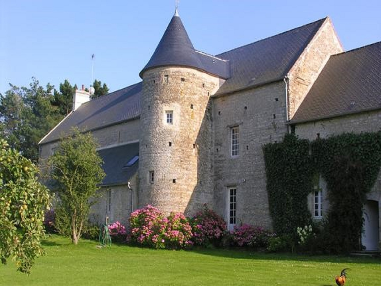 A large brick building at La Ferme Savigny.