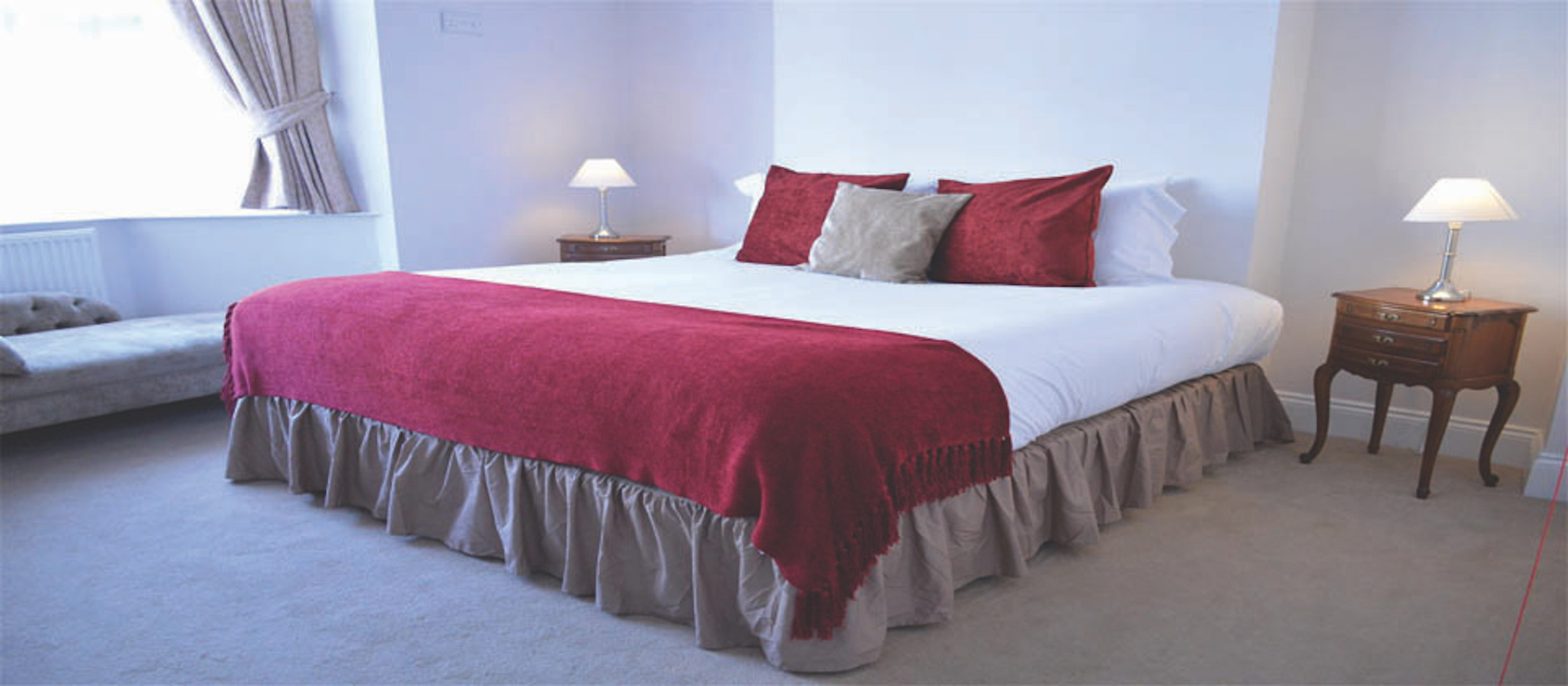 A bedroom with a large bed in a hotel room at The Oxford Osney Arms.