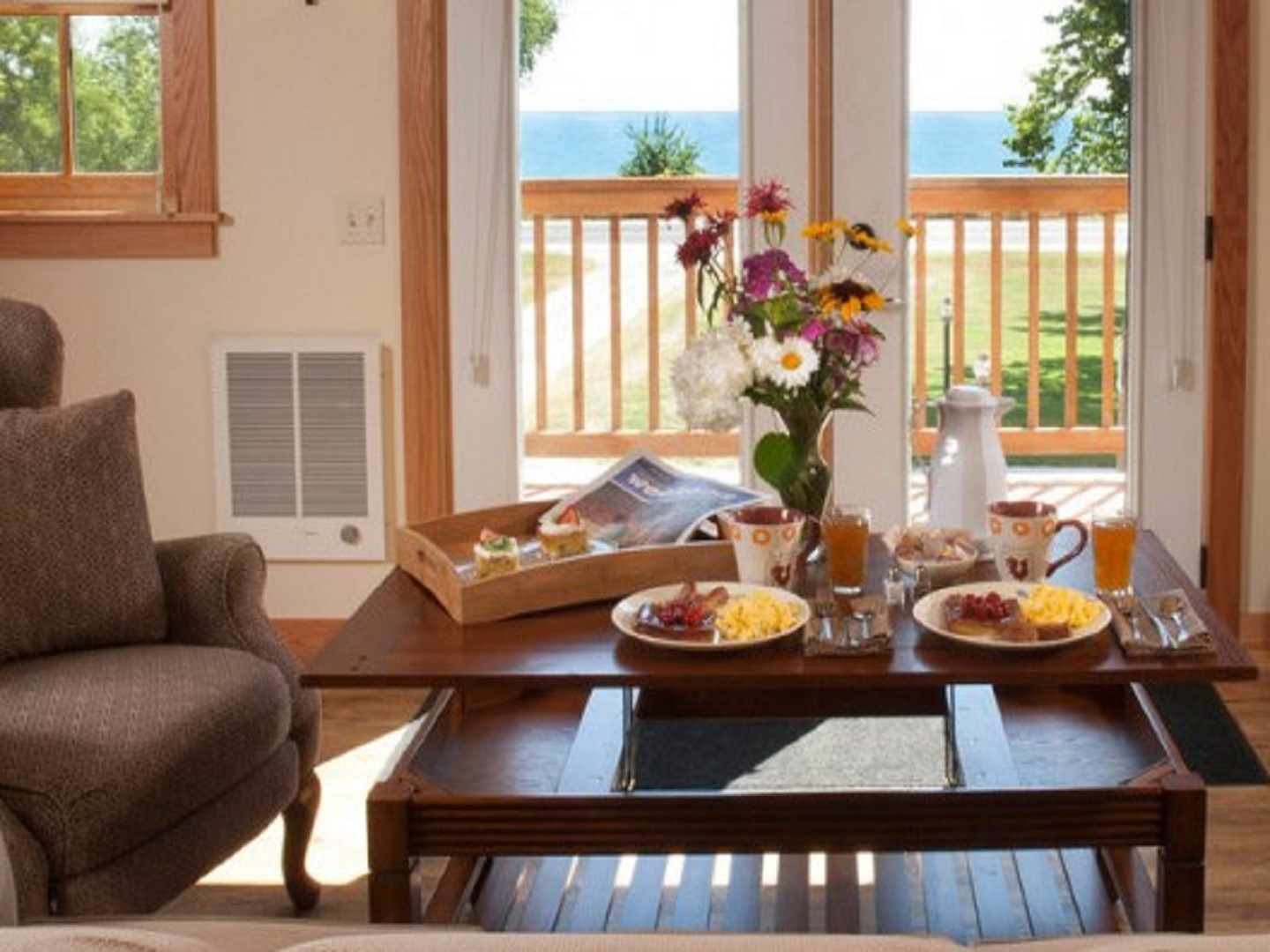 A dining room table in front of a window at Lake Orchard Farm Retreat.