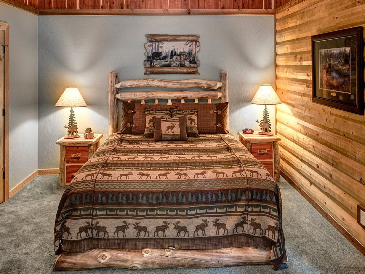 A bedroom with a large bed in a room at Lake Shore Cabins ON BEAVER LAKE.