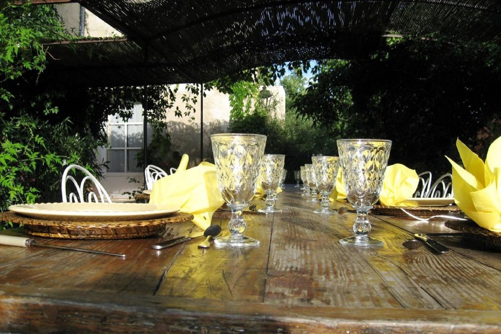 A glass vase on a table at Le Relais d'Elle.