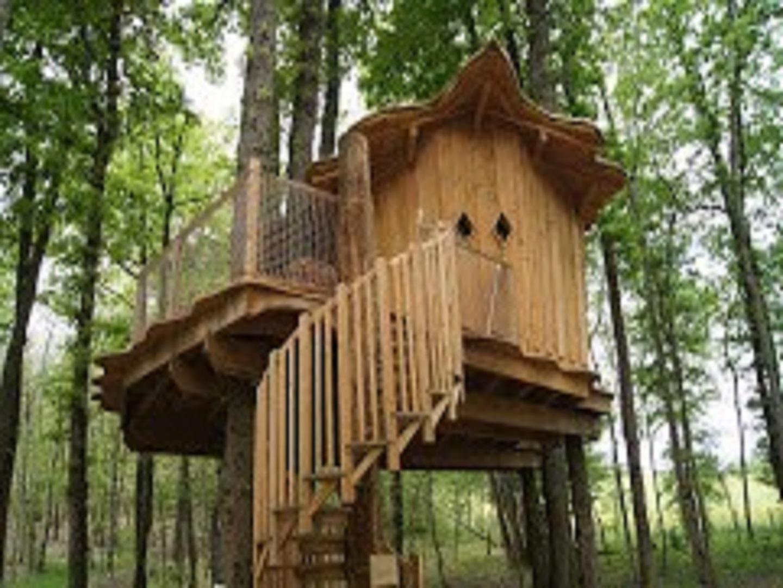 A birdhouse in a cage at Les cabanes de fontfroide.