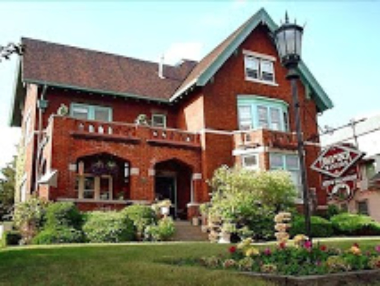 A large brick building at Brumder Mansion Bed & Breakfast.