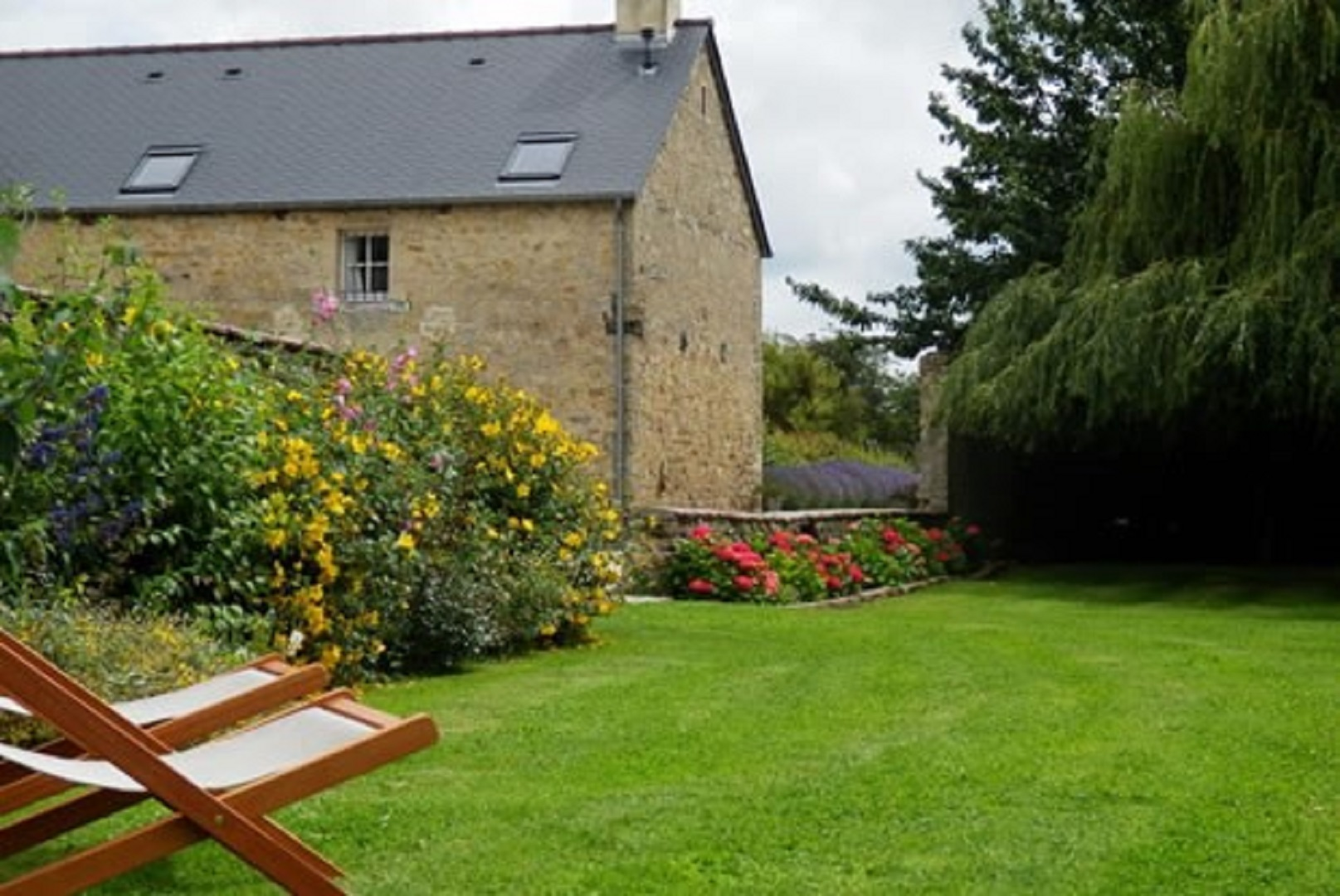 A bench in front of a house at LES CHAUFOURNIERS.