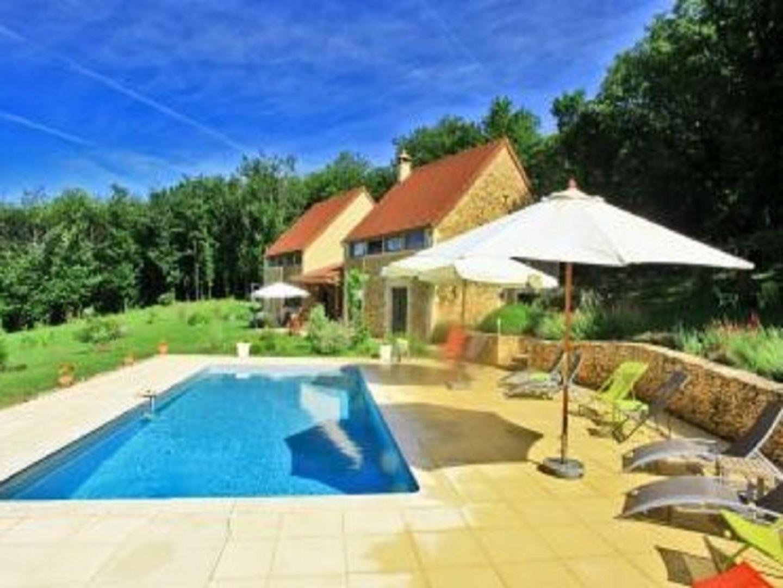 A house with a pool table at LES DEUX MOISELLES  Chambres d'hôtes entre Sarlat et Lascaux.