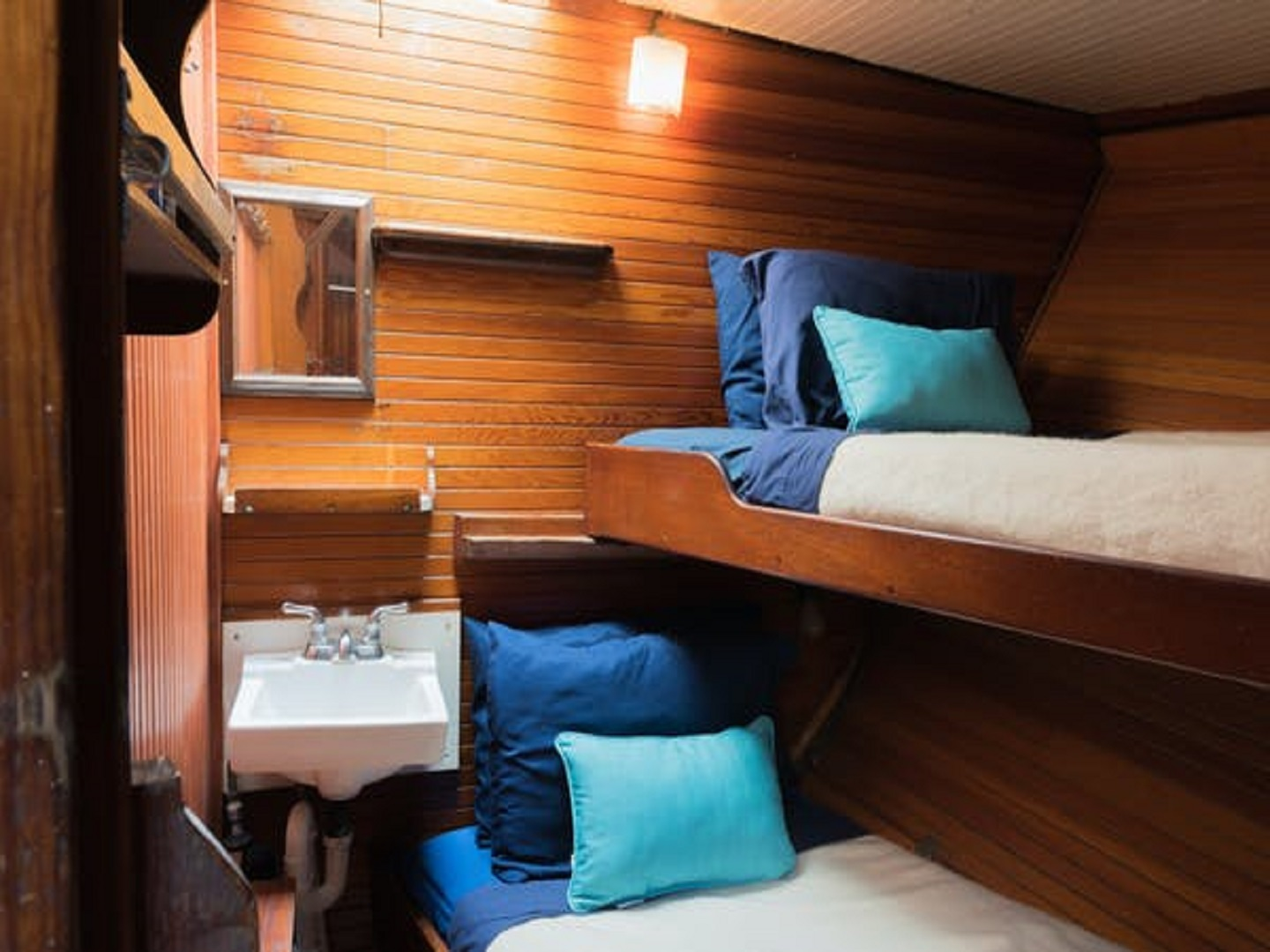 A bedroom with a bed and desk in a room at Liberty Fleet Tall Ship Overnights.