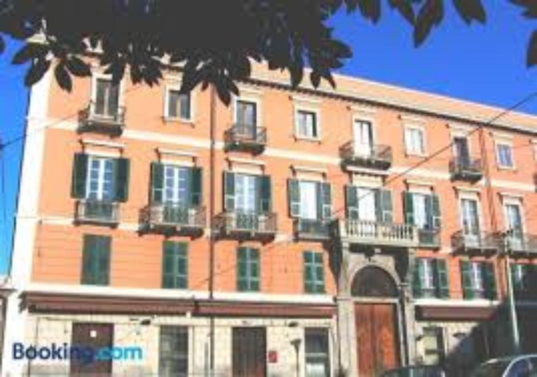 A large brick building at Ca del Sol B&B Cagliari.