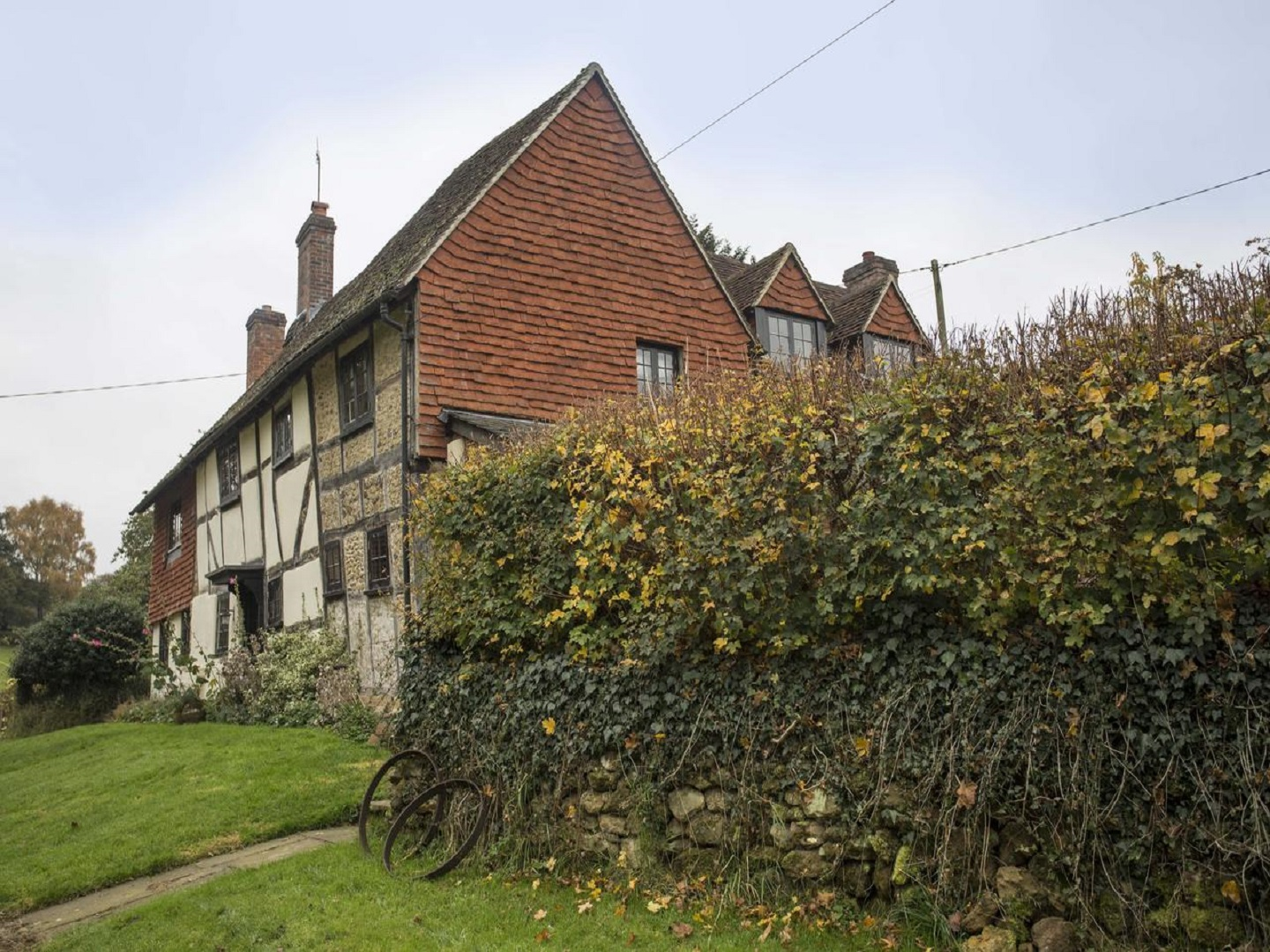 A large brick building with grass and trees at Lockhurst Hatch Farm.