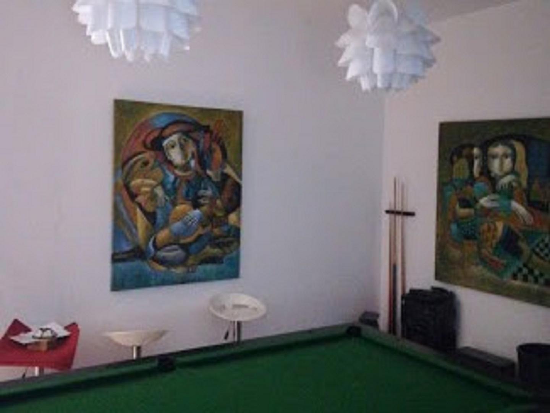 A painting hanging on a wall at 8 Villa.