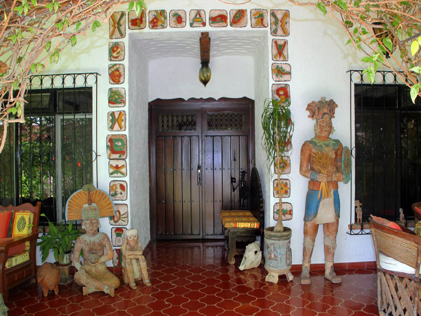 A person standing next to a fireplace at Los Artistas B & B.