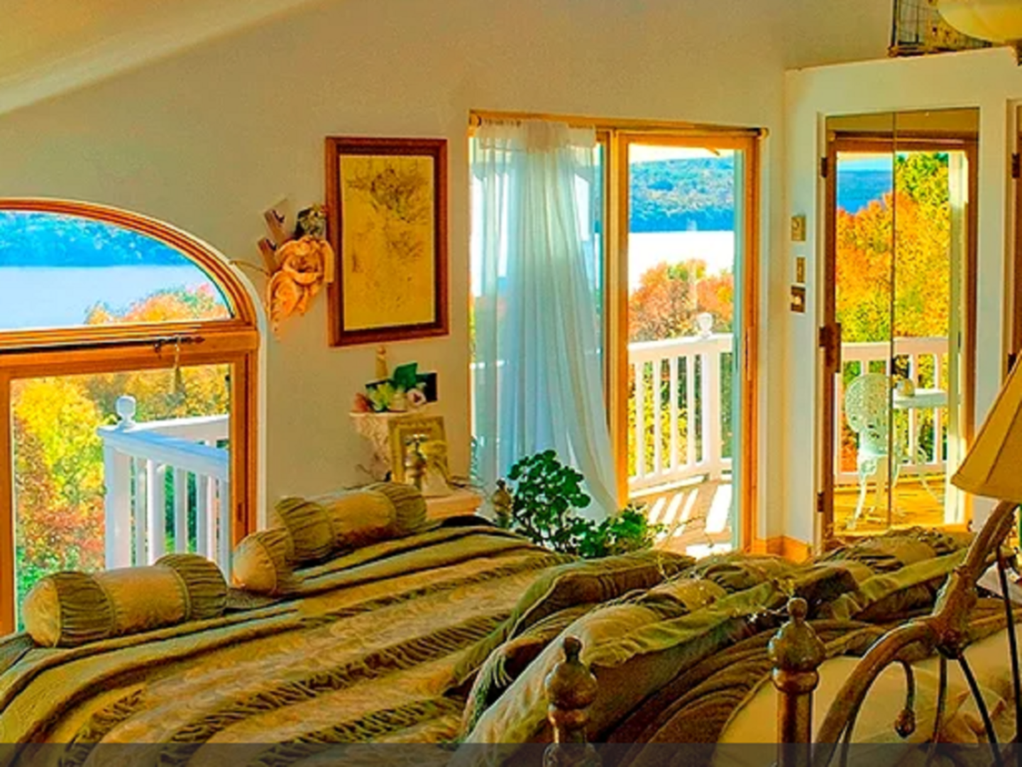 A living room filled with furniture and vase of flowers at Cayuga Lakefront Country Inn and Vineyard Villas.