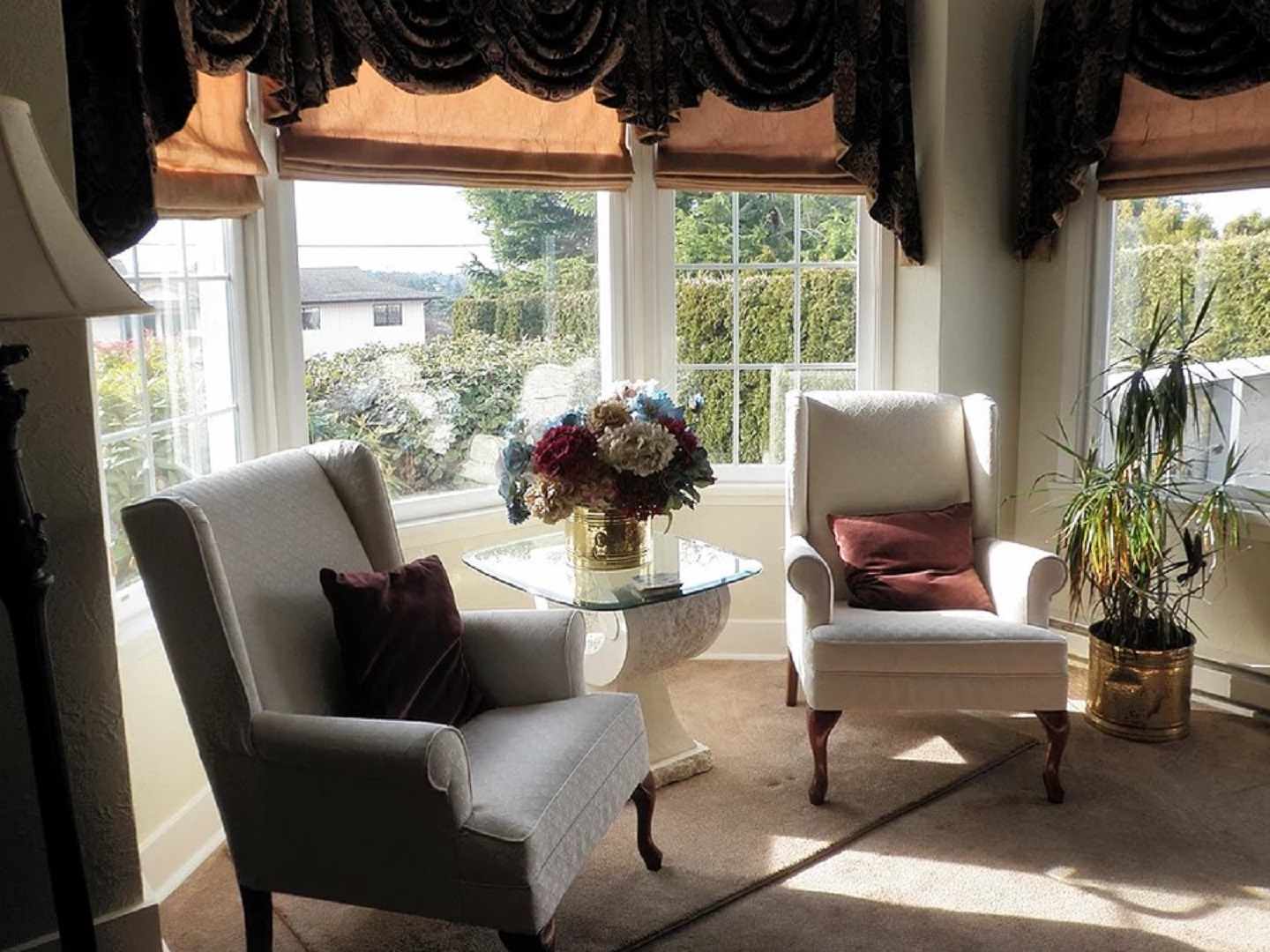 A living room filled with furniture and a large window at A Good Knight B&B.