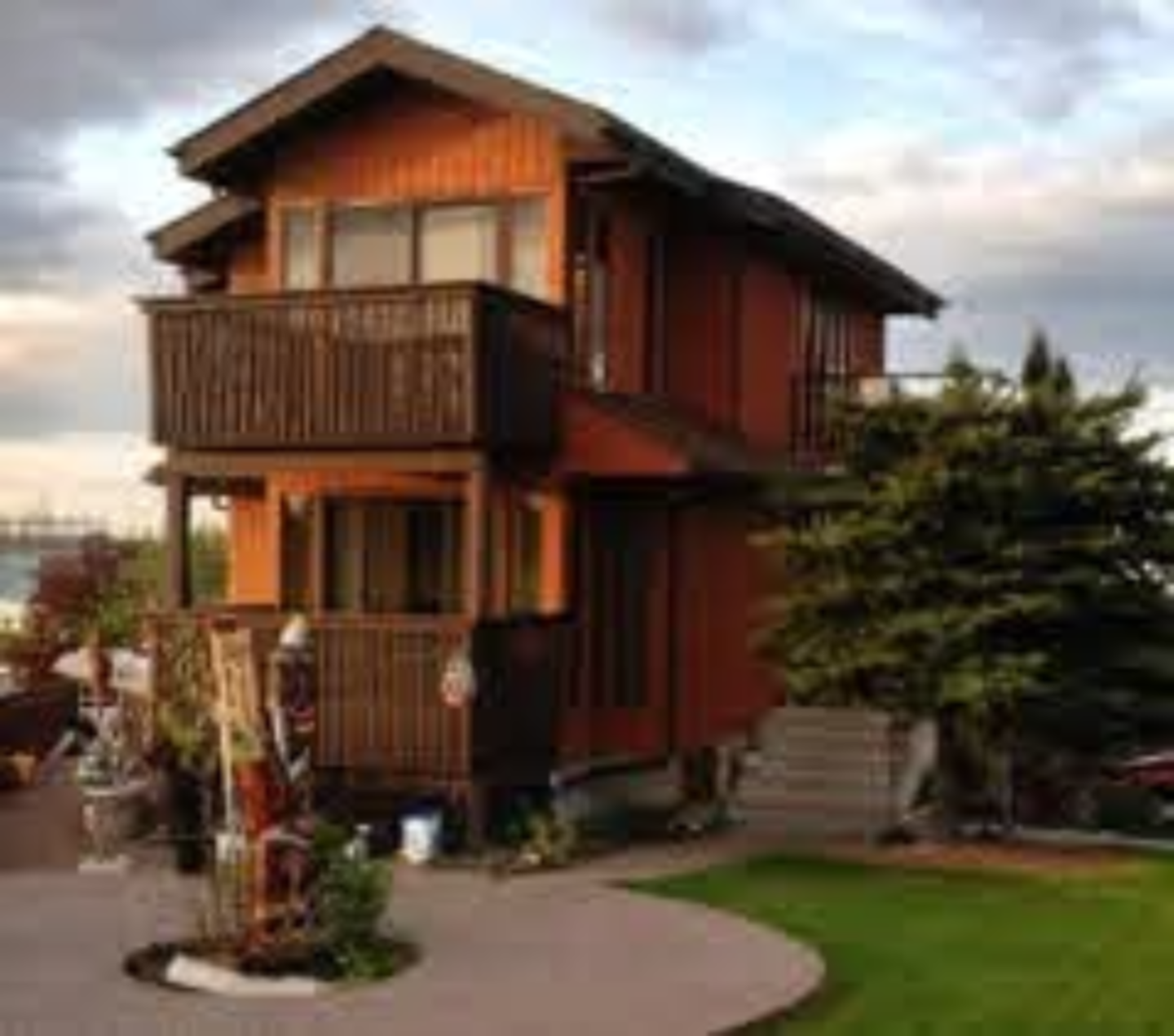 A house with trees in the background at Calgary City View Bed & Breakfast.