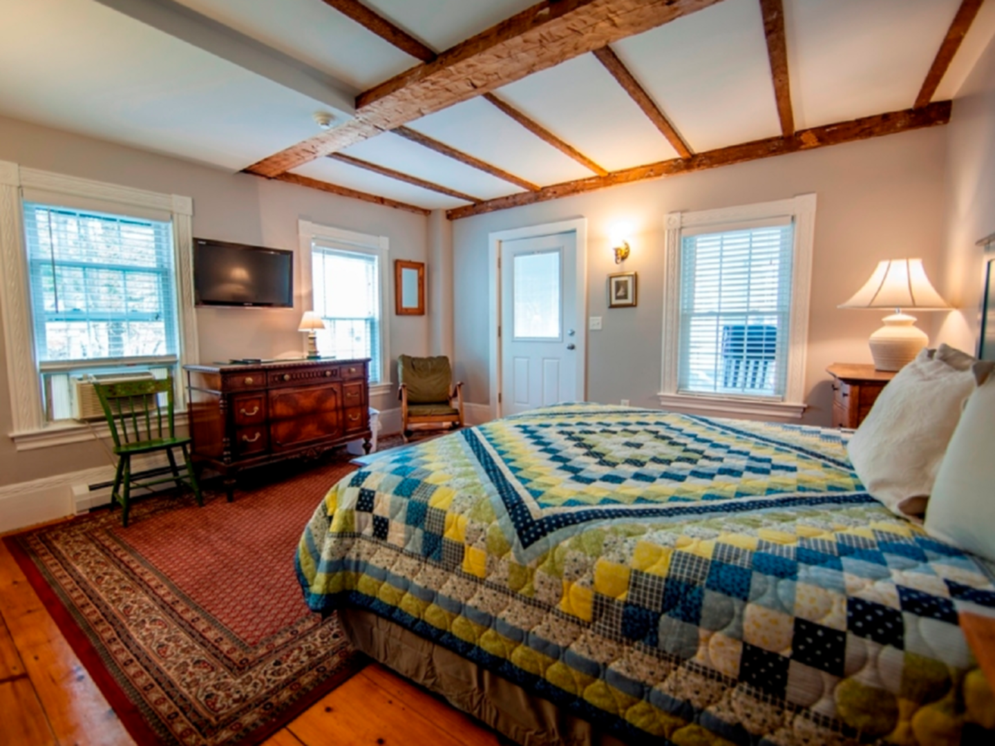 A bedroom with a large bed in a room at Abalonia Inn.