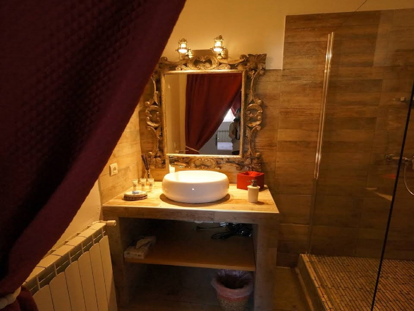 A room with a sink and a mirror at Mas des Ozieres, Luberon en Provence.
