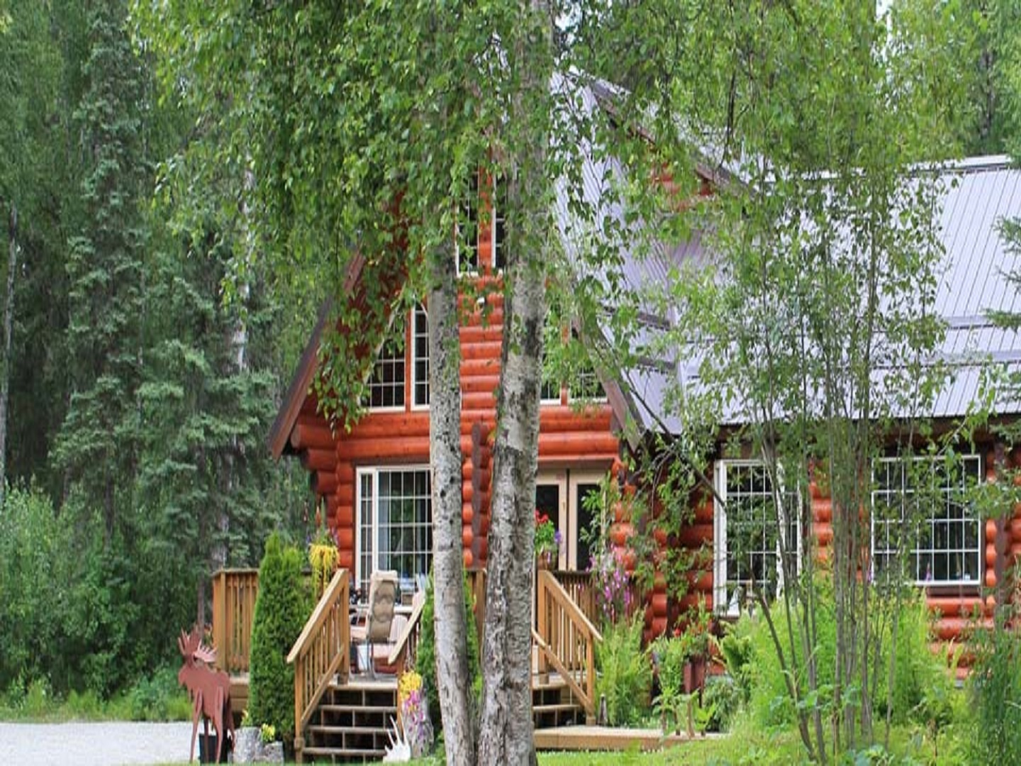 A tree in front of a building at Meandering Moose Lodging.
