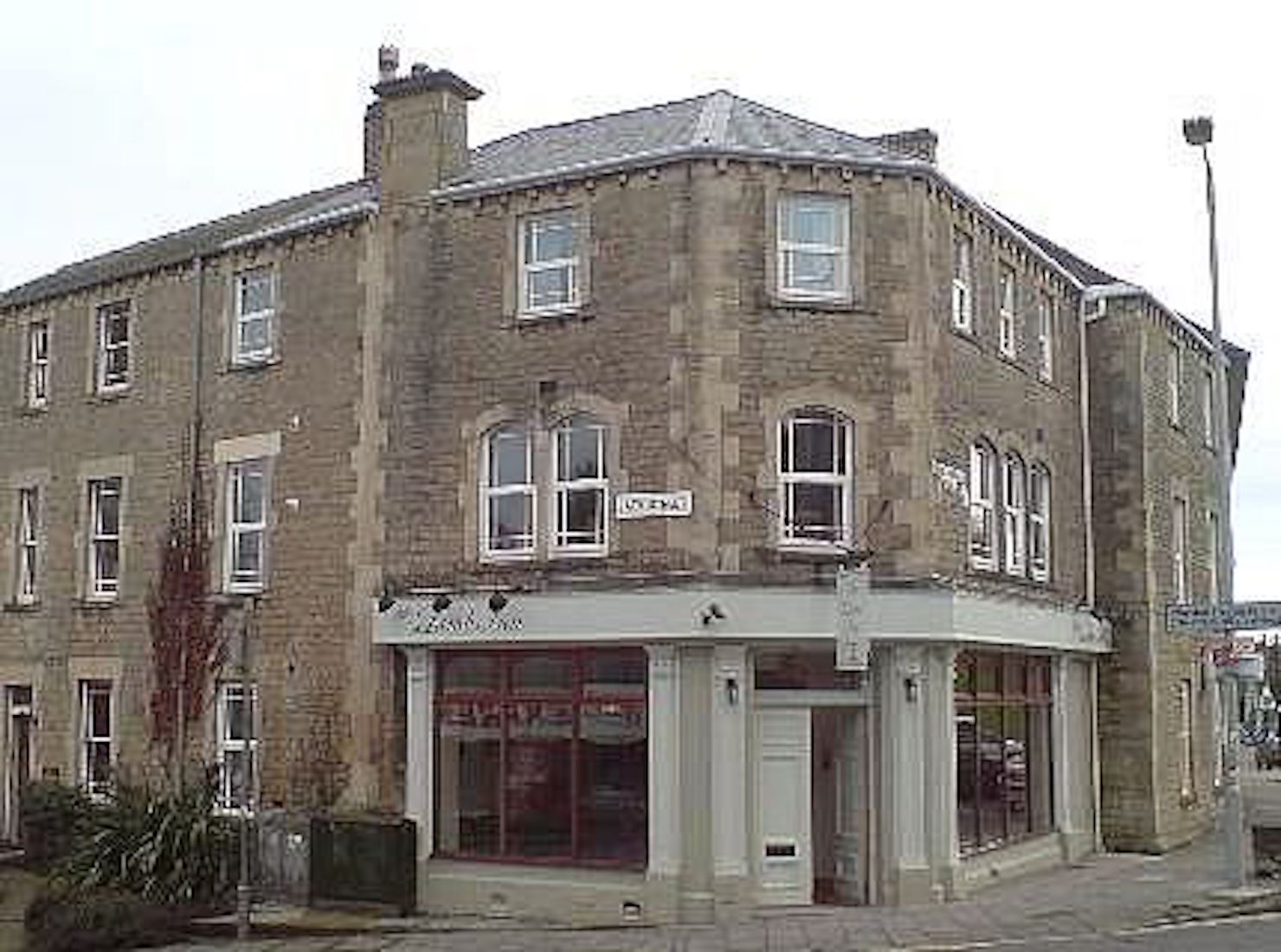 A large brick building at Frome Corner.