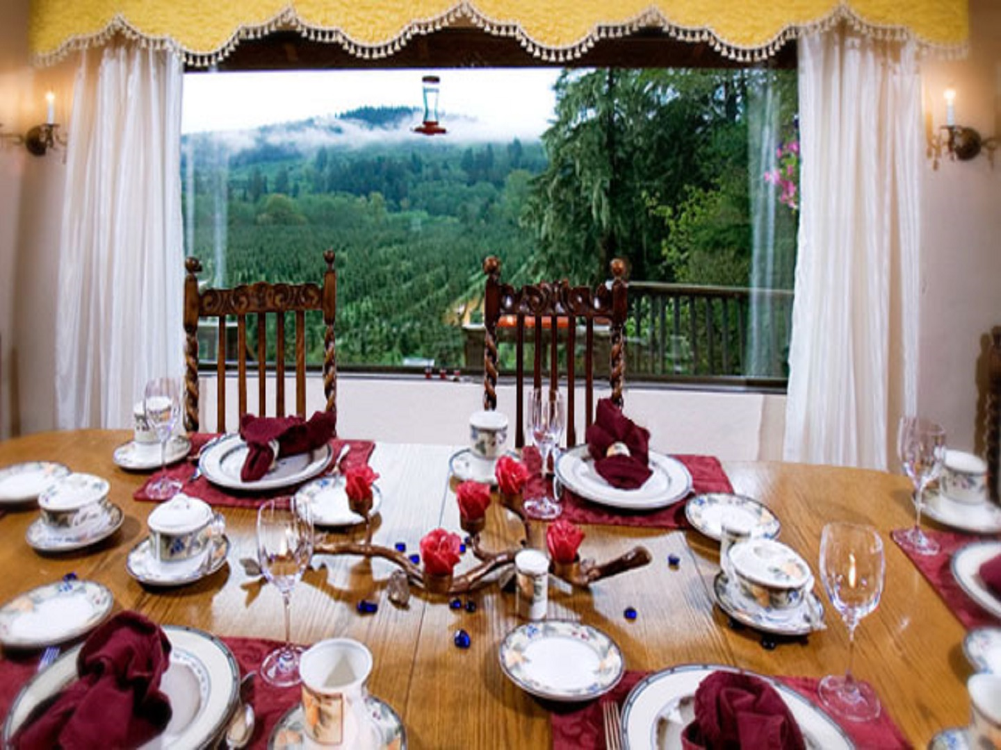 A dining room table in front of a curtain at Misty Valley Inn.