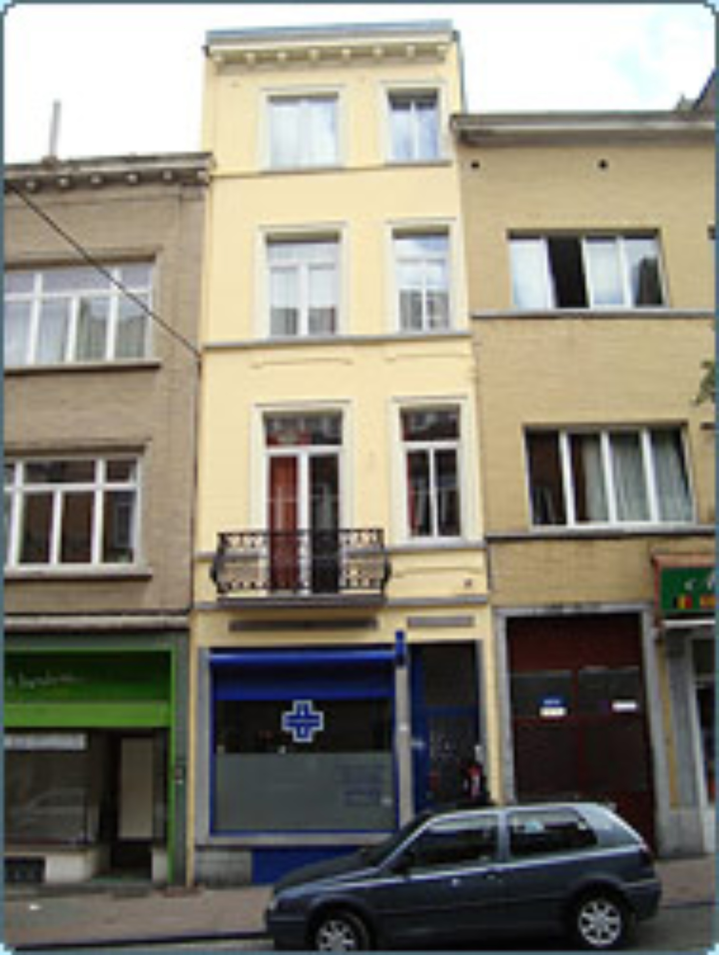 A building next to a window at CASA BELGO ARGENTINA.