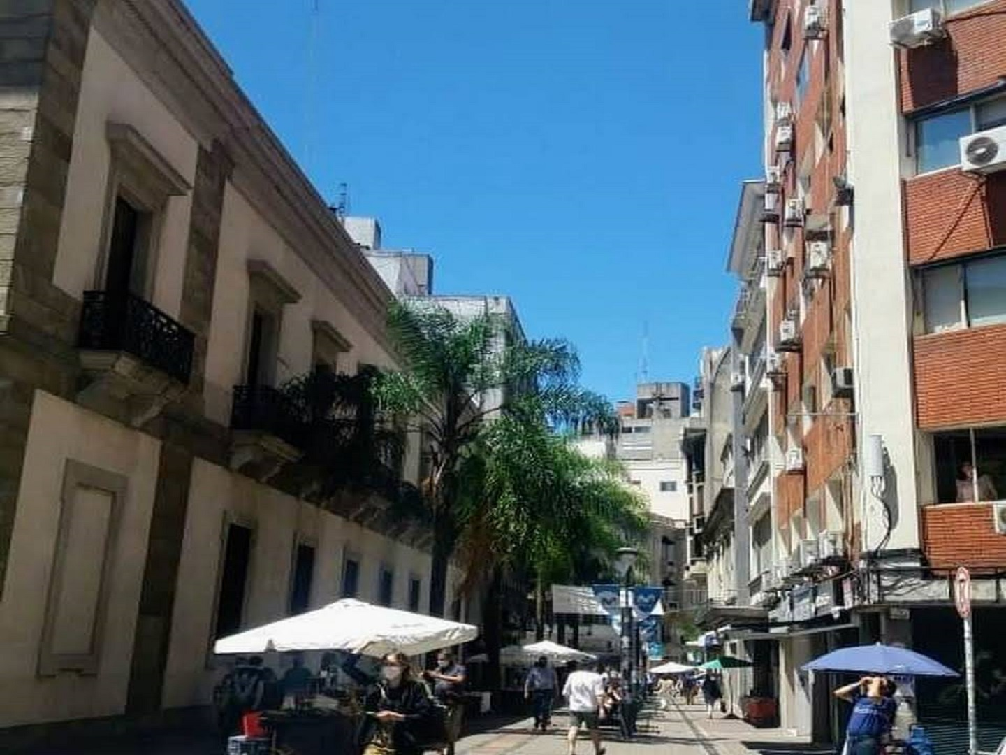 A narrow city street with buildings on the side of a building at Montevideo Port Hostel.