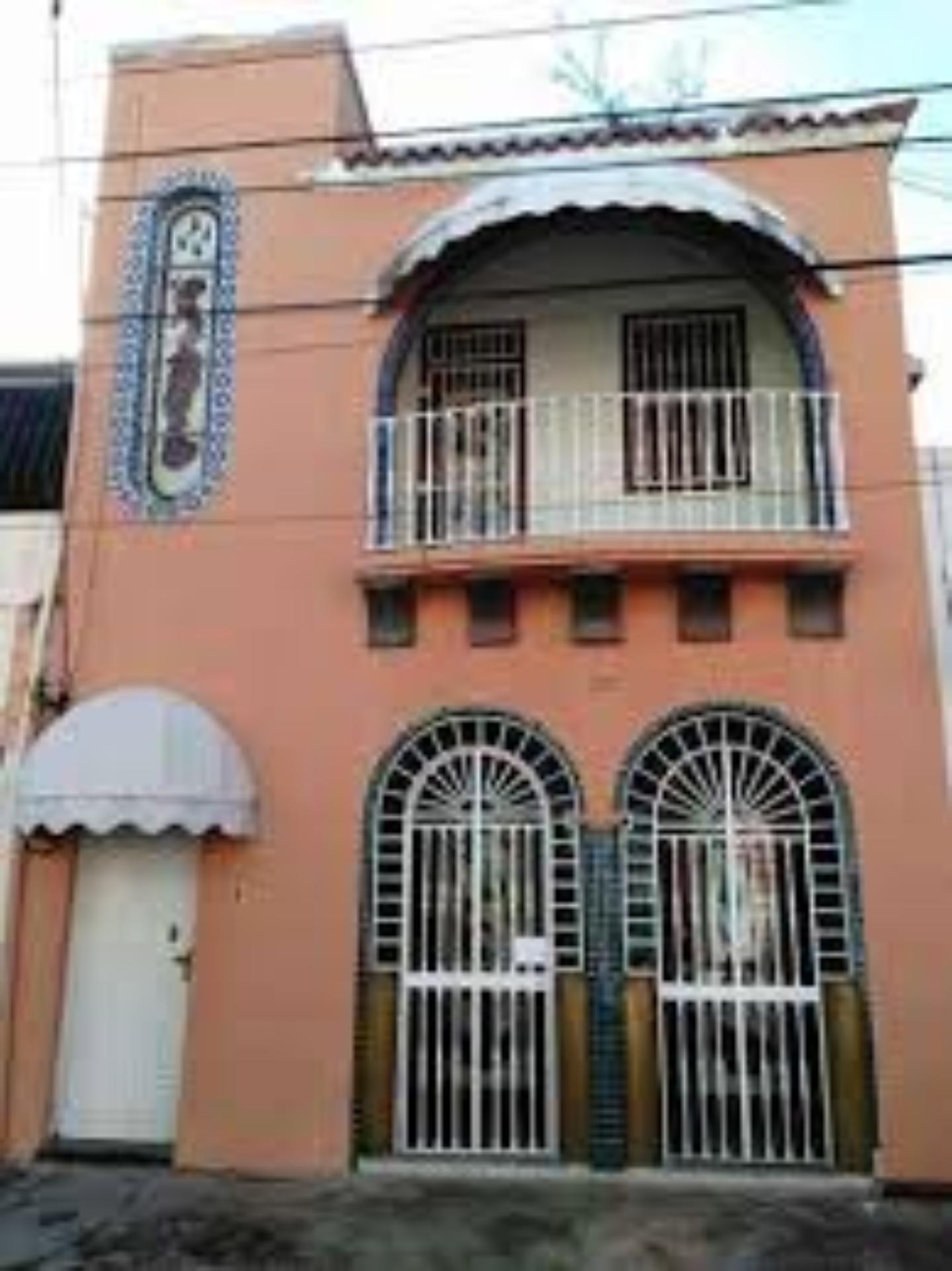 A building next to a window at Casa Florian.