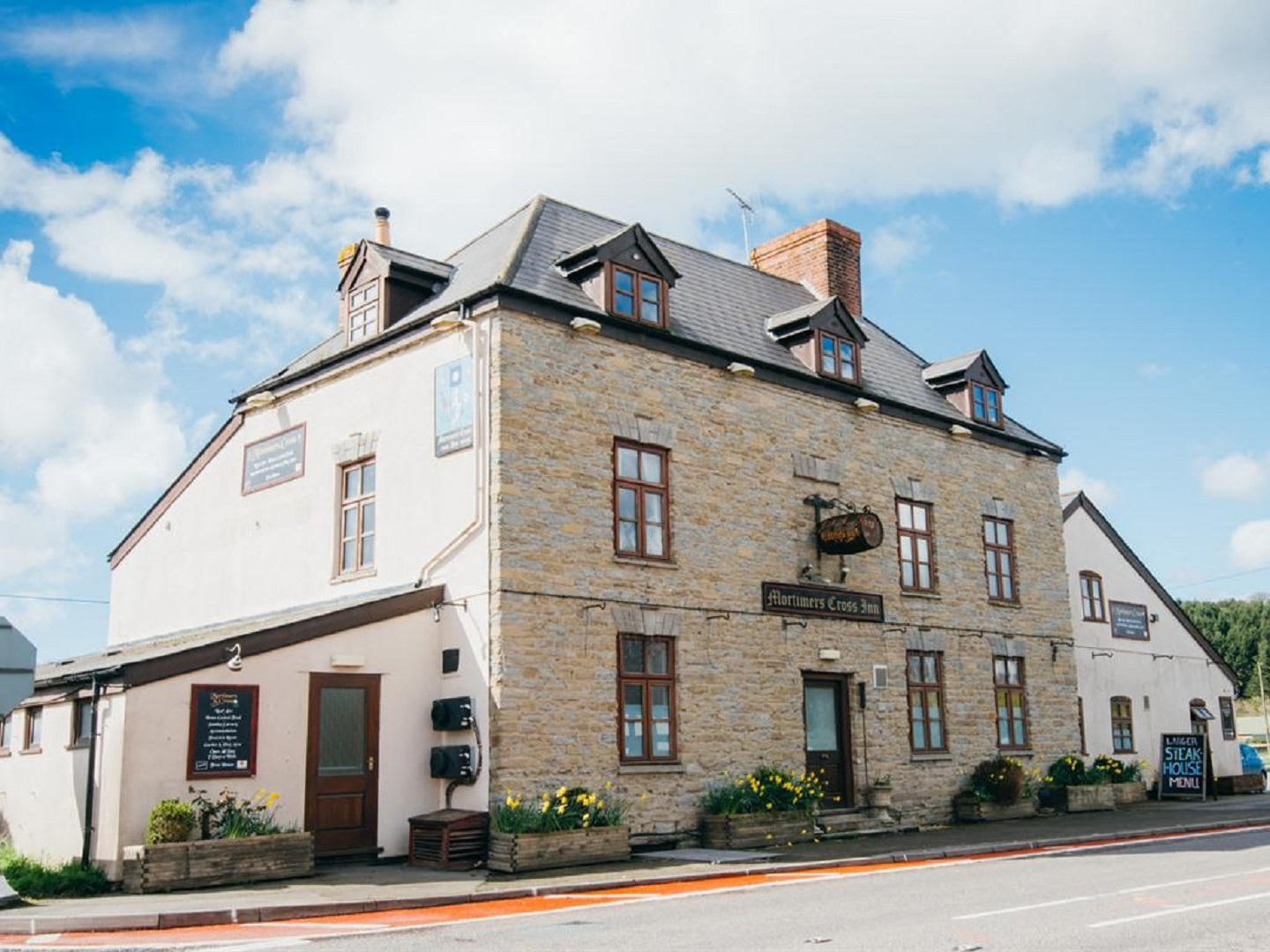 A large brick building at Mortimers Cross Inn.