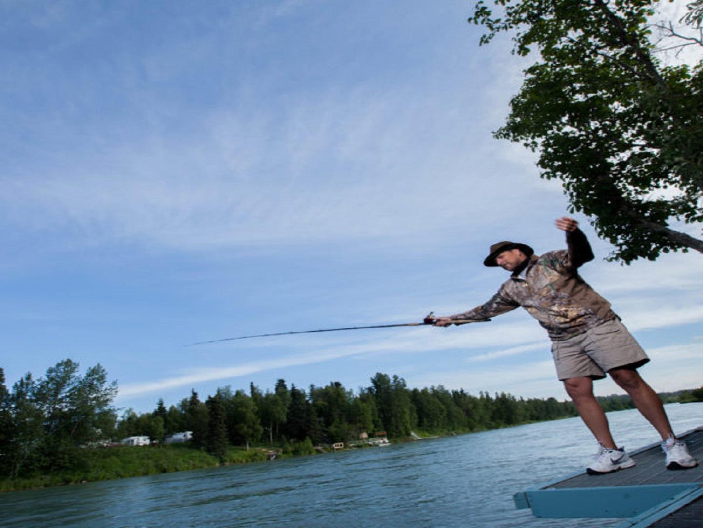 A man jumping in the air at Alaska Fishing Lodge and Soldotna B&B Charters.