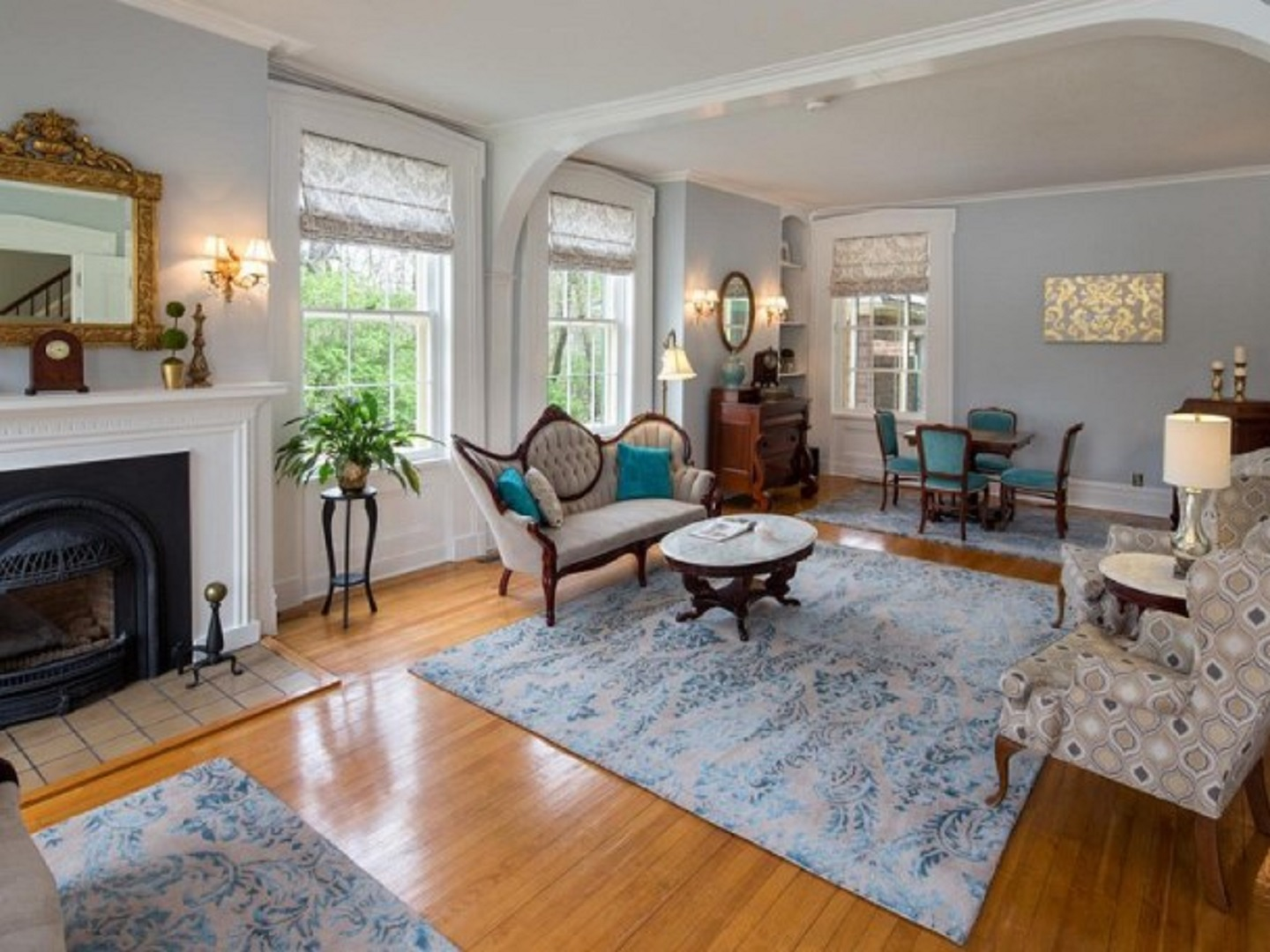 A living room filled with furniture and a fire place at Aldrich House Bed & Breakfast.