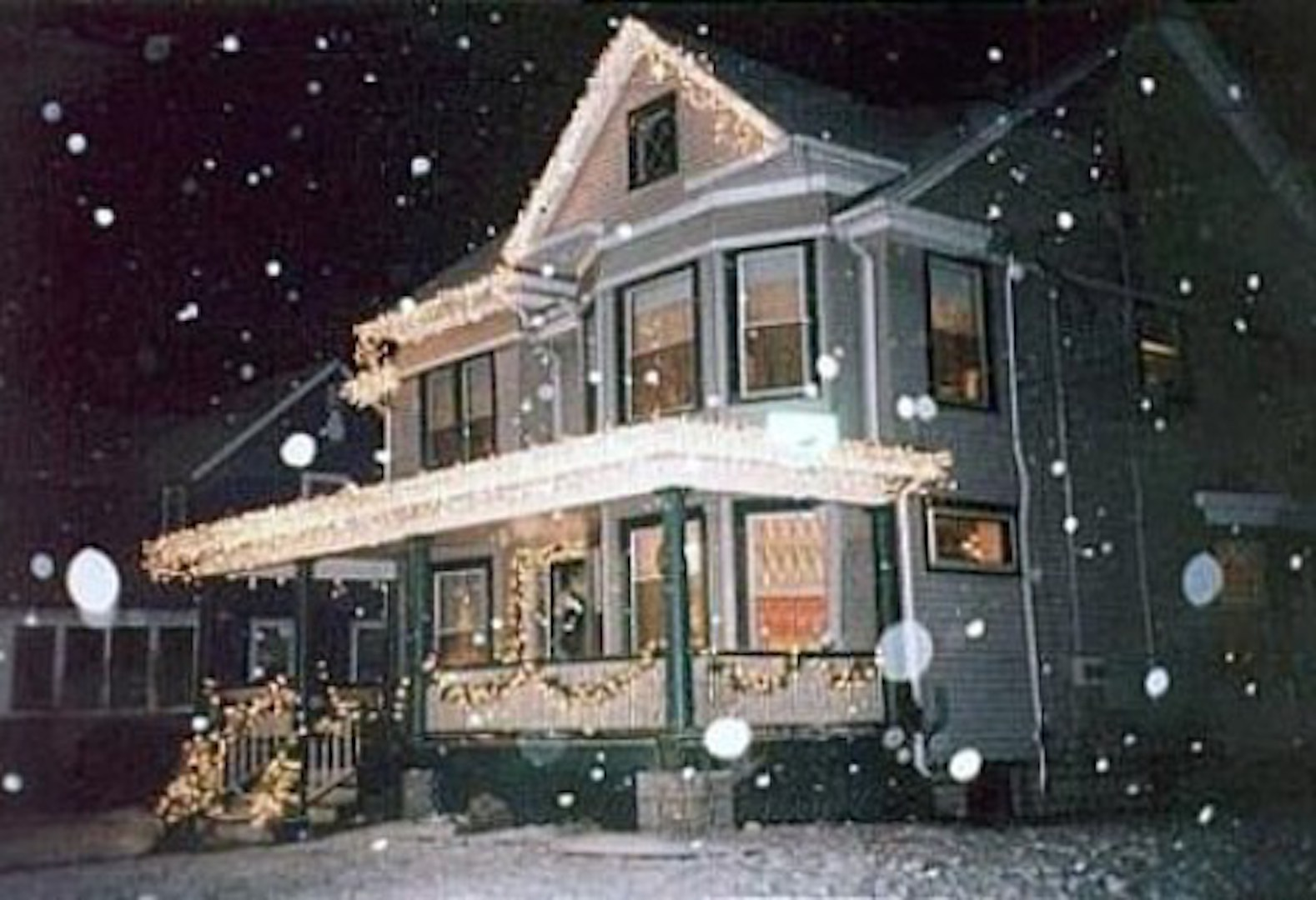 A train is parked on the side of a building at Gilded Swan Bed & Breakfast.