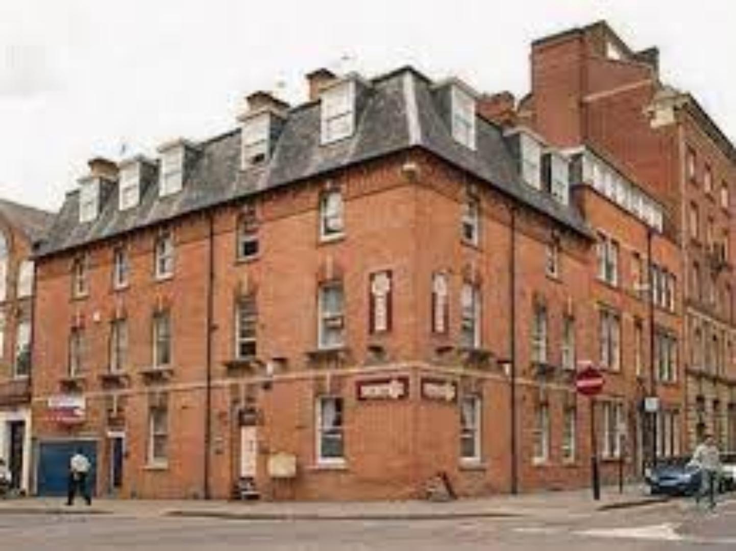 A large brick building at Castle Park Hotel.
