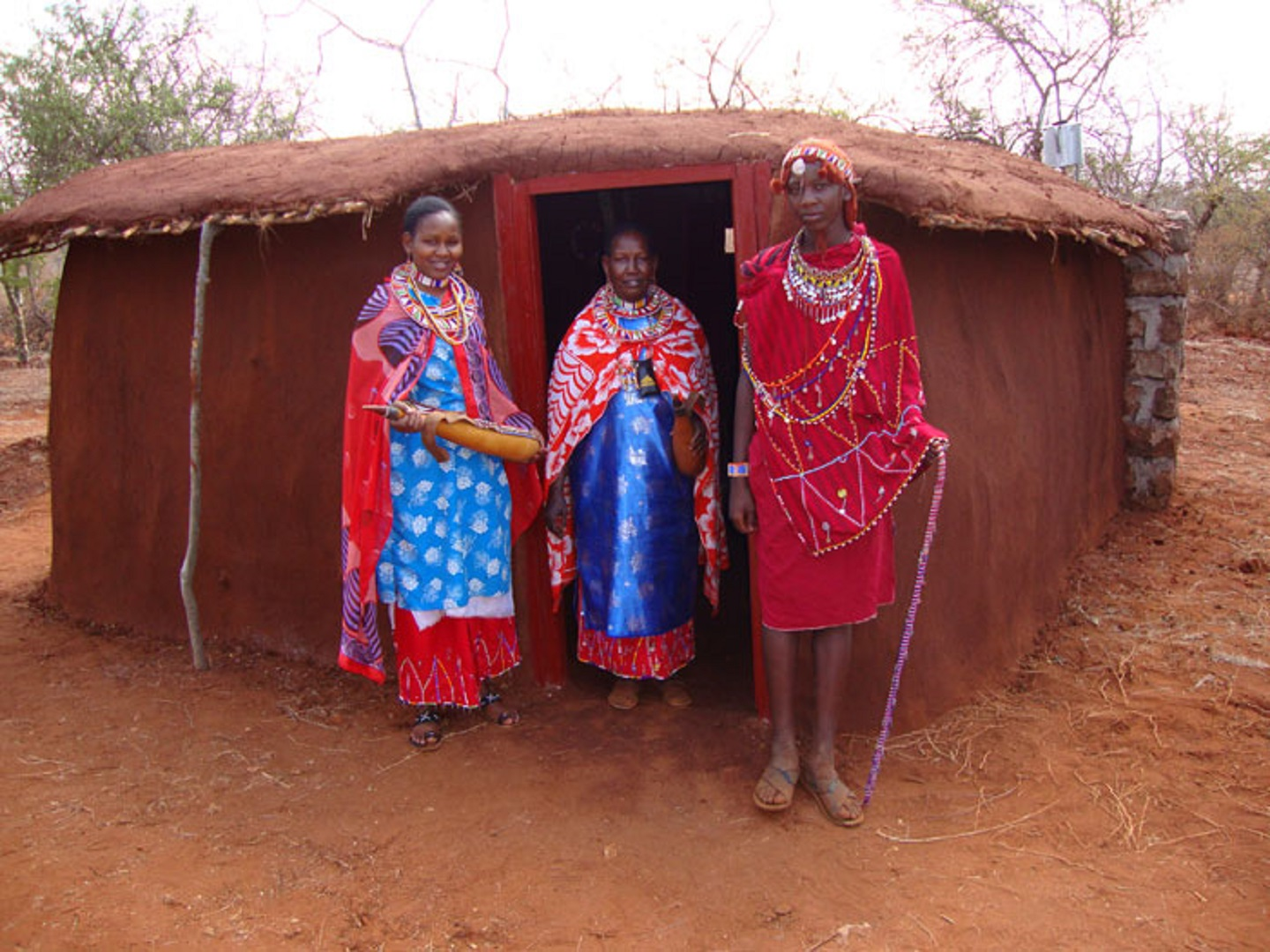 A person standing in front of a building at Muteleu Maasai Traditional Village.