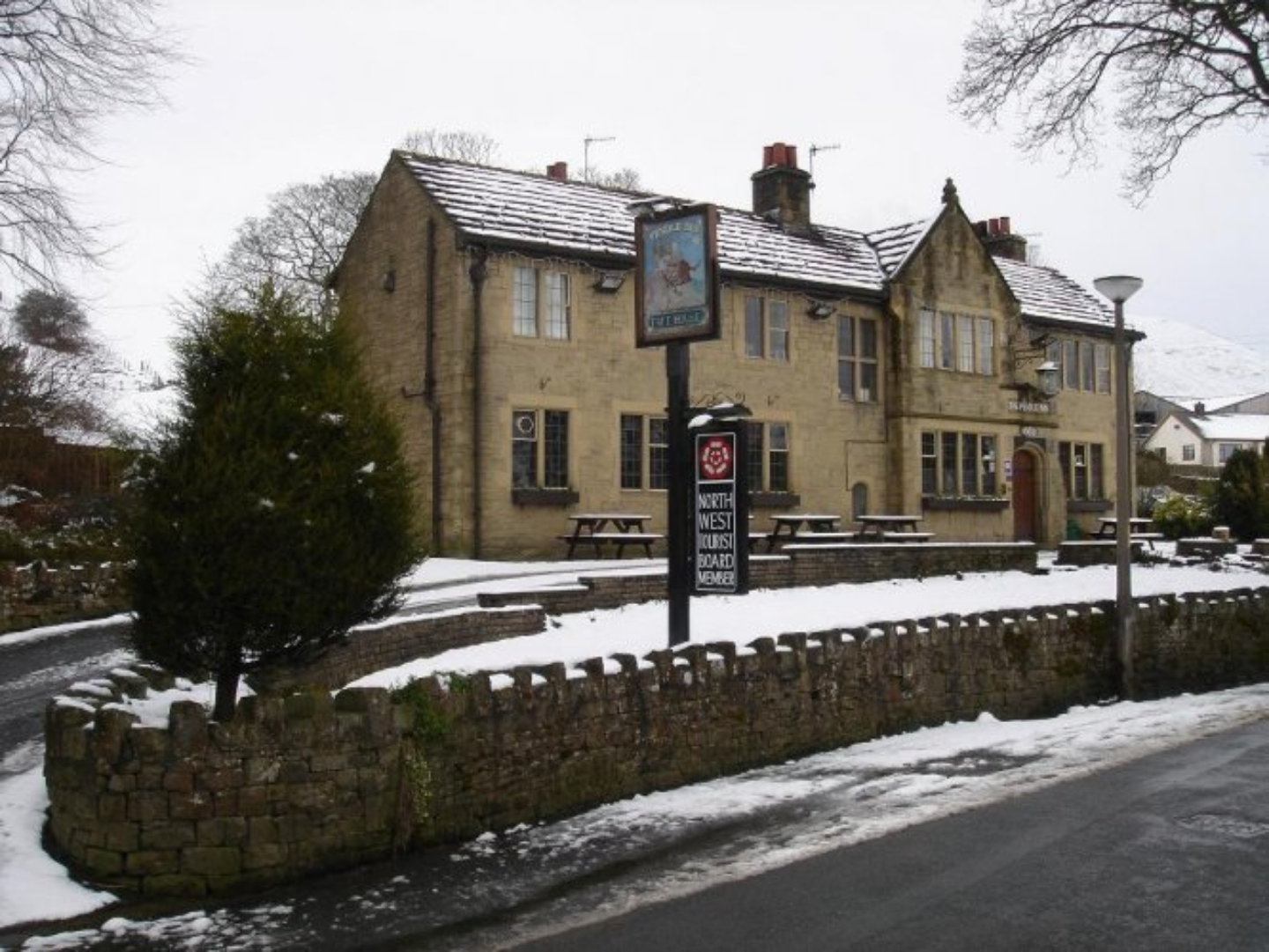A house covered in snow at The Pendle Inn.