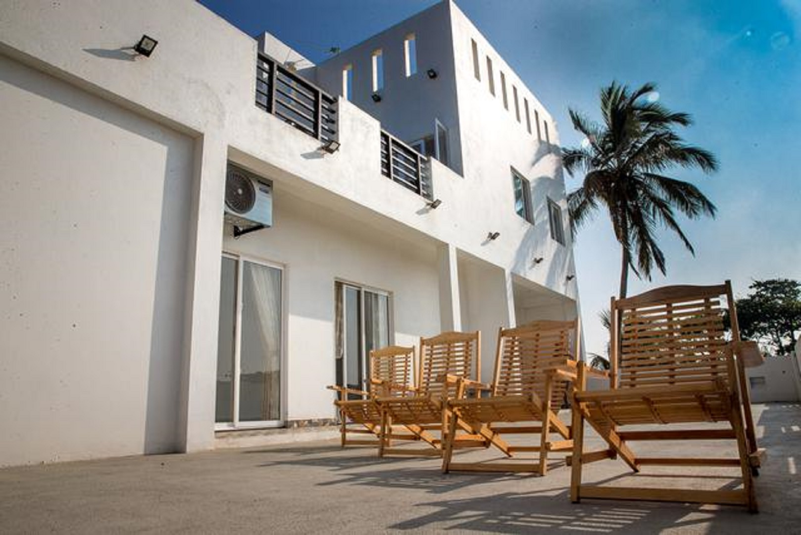A chair sitting in front of a building at Negombo BnB.