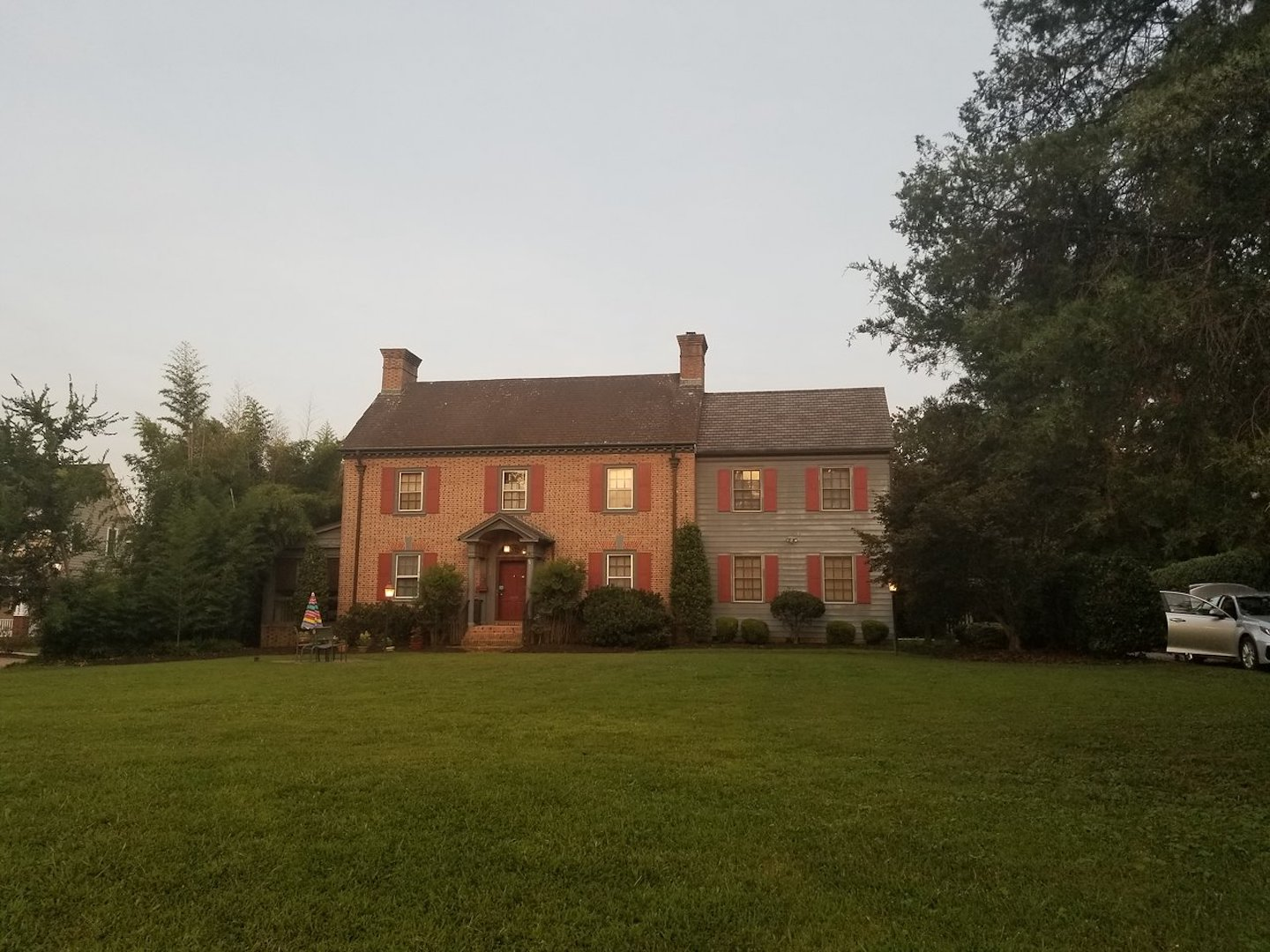 A large brick building with grass in front of a house at Governor's Trace B&B.
